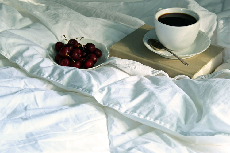 Coffee cup on bed