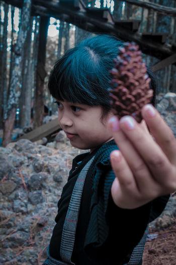 Portrait of boy holding ice cream outdoors