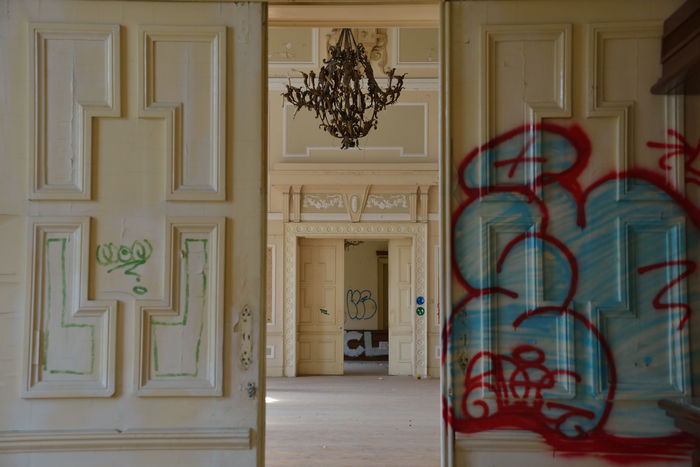 ex military barracks abandoned - ballroom officers Abandoned Antique Chandelier Architecture Ballroom Door Graffiti Indoors  Military Barracks No People Trieste Vandalism The Secret Spaces EyeEmNewHere Art Is Everywhere