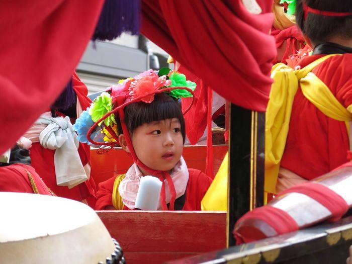 Cute Girl Looking Away While Sitting In Sedan Chair During Festival