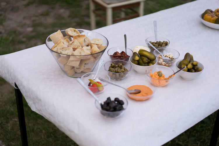 Close up of food on table with bread and dips