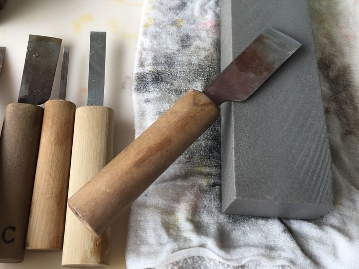 Close-up of knives on table