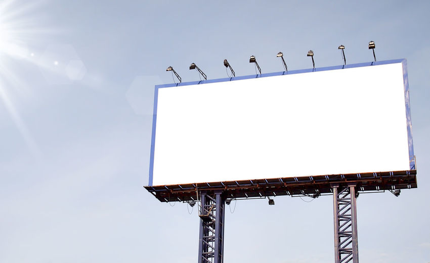 Advertisement Animal Themes Animal Wildlife Animals In The Wild Billboard Bird Blank Clear Sky Communication Copy Space Day Lighting Equipment Low Angle View Marketing Nature No People Outdoors Sign Sky Sunlight White Color