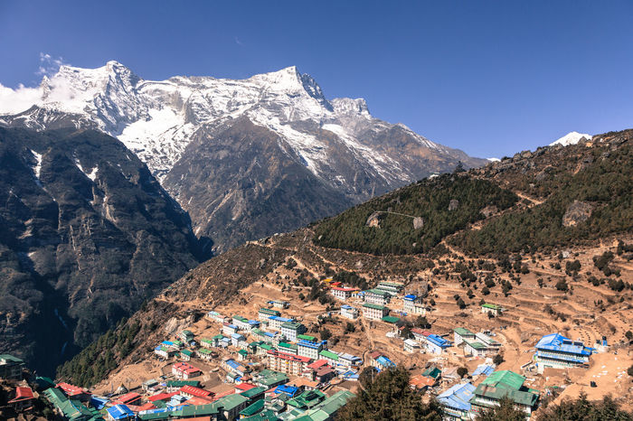 Namche Bazar in Nepal is the main village in the Khumbu region in the Himalayas on the populair hiking tail that leads to the Everest base camp Architecture Beauty In Nature Blue Building Exterior Clear Sky Day Himalayas Khumbu Himalaya Landscape Mountain Mountain Range Namche Bazaar Nature Nepal No People Outdoors Scenics Sky Snow Capped Mountains Tranquility Travel Destinations Traveling Home For The Holidays Tree Valley First Eyeem Photo