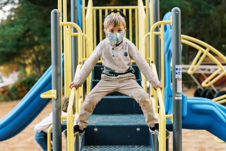 Portrait of boy playing in playground