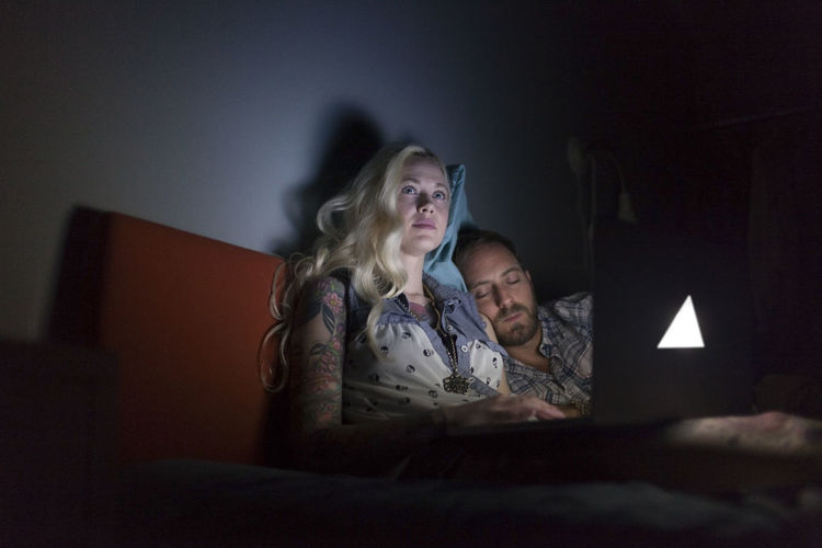 Women sitting on bed at home