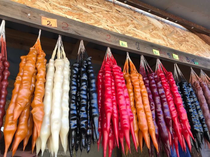Multi colored food hanging in market for sale