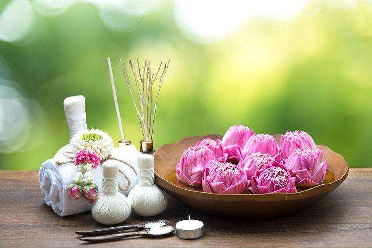 Close-up of pink flowers on table