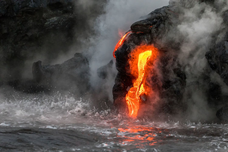 Heat - Temperature Smoke - Physical Structure Motion Water Geology Nature No People Steam Volcano Power Lava Power In Nature Land Outdoors Environment Beauty In Nature Sea Sign Rock - Object Flowing Hot Spring Pollution Big Island Hawaii