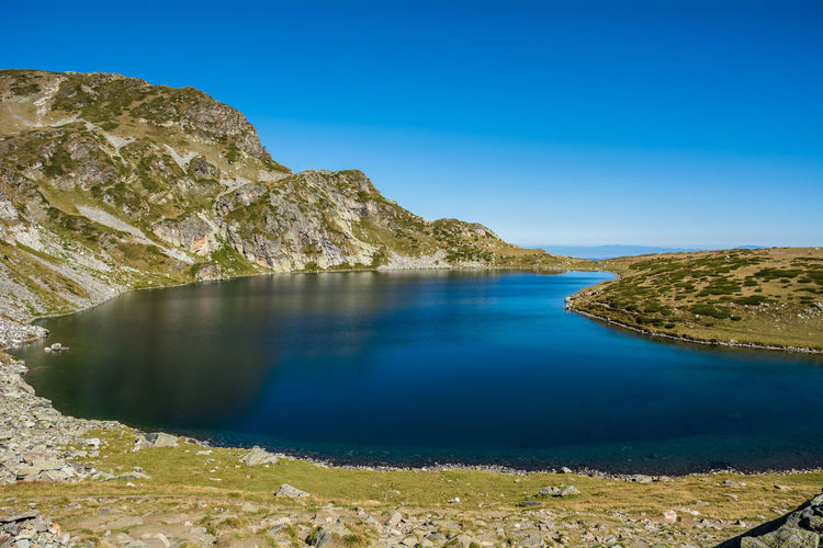 Seven Rila lakes, Bulgaria; The Kidney Бъбрека (Babreka) 2,282 m (7,487 ft) 8.5 ha (21 acres) 28.0 m (91.9 ft) Water Scenics - Nature Tranquil Scene Tranquility Beauty In Nature Blue Sky Rock Rock - Object Clear Sky Mountain Idyllic Solid Lake Nature Day Non-urban Scene No People Land Outdoors Formation Lake View Nature Nature_collection Nature Photography Stay Out
