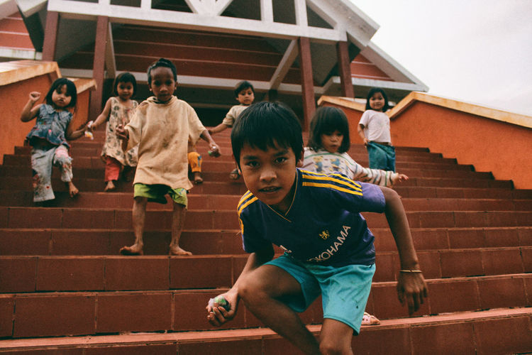 Children playing on steps