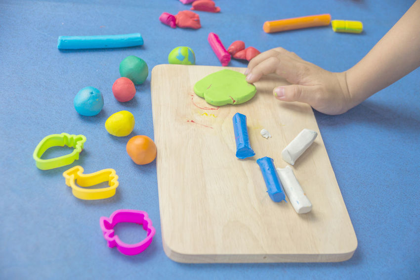 My son plays the clay Molding Clay Childhood Clay Close-up Cutting Board Day High Angle View Human Body Part Human Hand Indoors  Learning Leisure Activity Making Multi Colored One Person People Preparation  Real People Table Toy