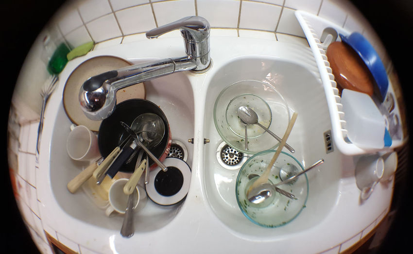 High angle view of dirty dishes in sink
