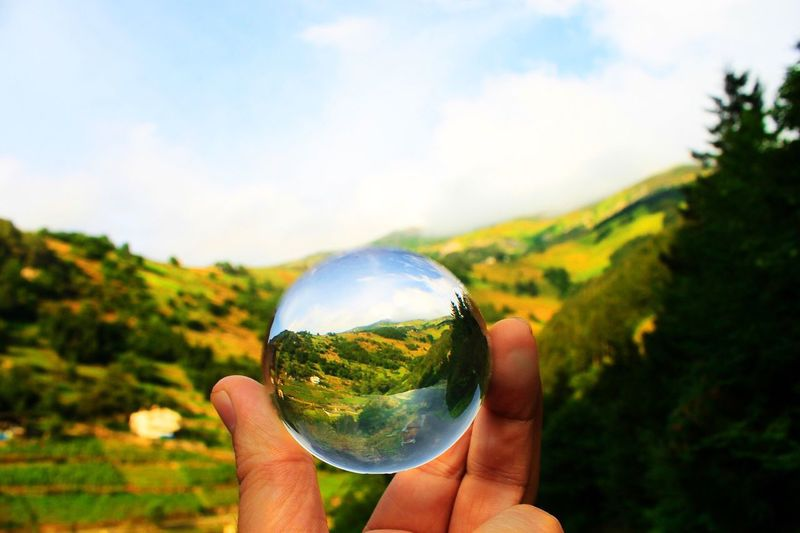 Focus On Foreground Human Hand Sky Nature Outdoors Mountain Landscape Holding Human Finger One Person Human Body Part Real People Personal Perspective Tree Close-up Day People Quartz Crystal Crystal Ball Crystal Crystal Clear
