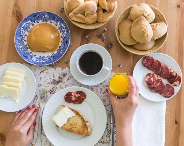 Coffee Bread Breakfast Coffee - Drink Coffee Cup Day Directly Above Drink Food Food And Drink Freshness Healthy Eating High Angle View Holding Human Body Part Human Hand Indoors  Lifestyles One Person People Plate Ready-to-eat Real People Refreshment Table Women