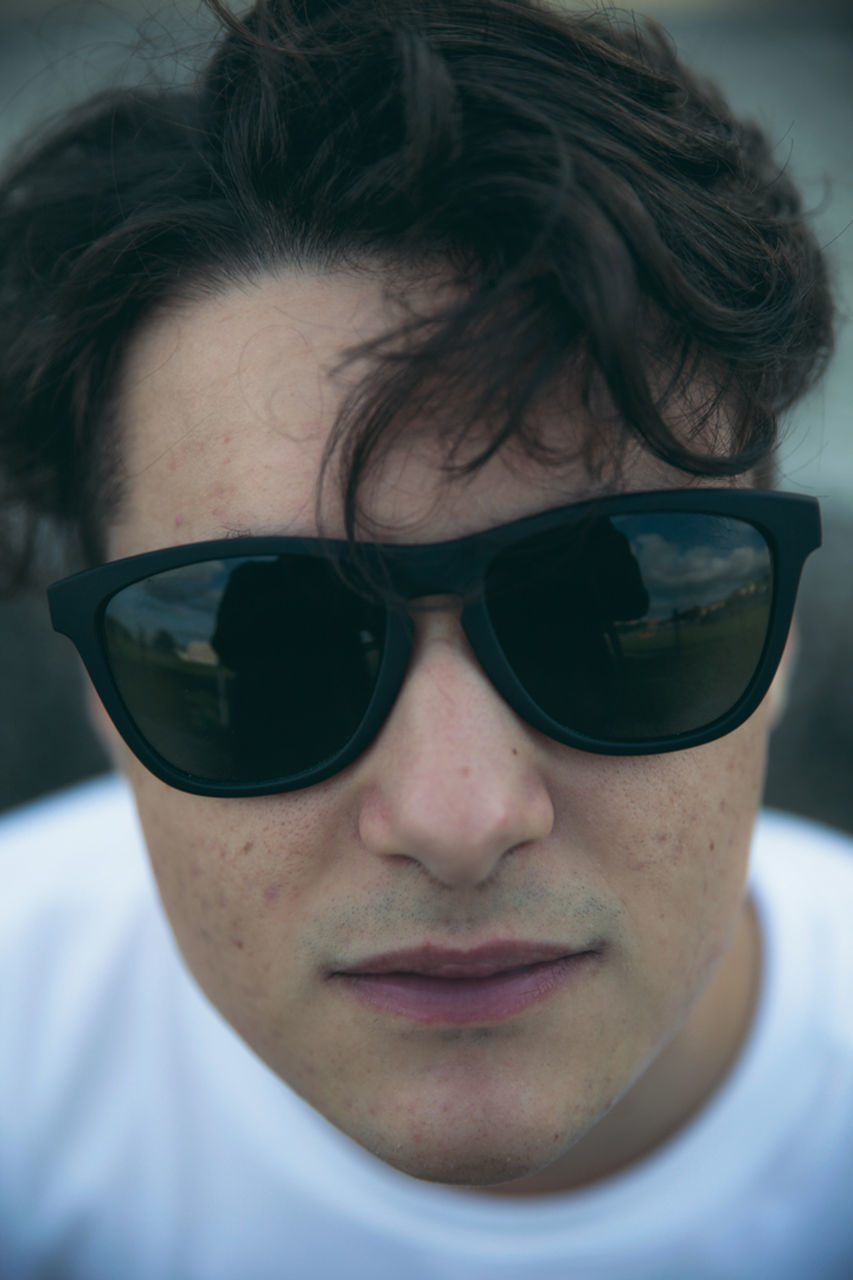 portrait, glasses, headshot, one person, close-up, real people, sunglasses, front view, fashion, lifestyles, young men, young adult, men, looking at camera, focus on foreground, human body part, body part, human face, personal accessory