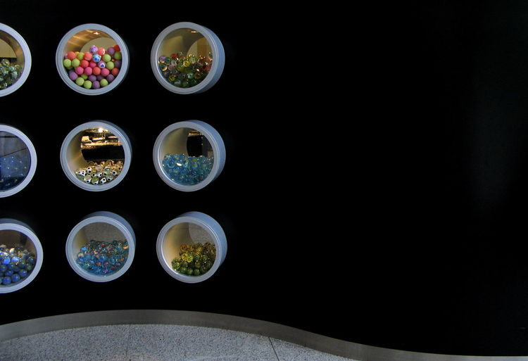 Art Museum Art Museum, Bonn Balls Black Black Color Black Wall Bonn Art Museum Centered Circle Circles Colored Marbles Curve Curved Wall Display Unit Displays Marbles Multi Colored Multicolors  Round Small Balls White Circles