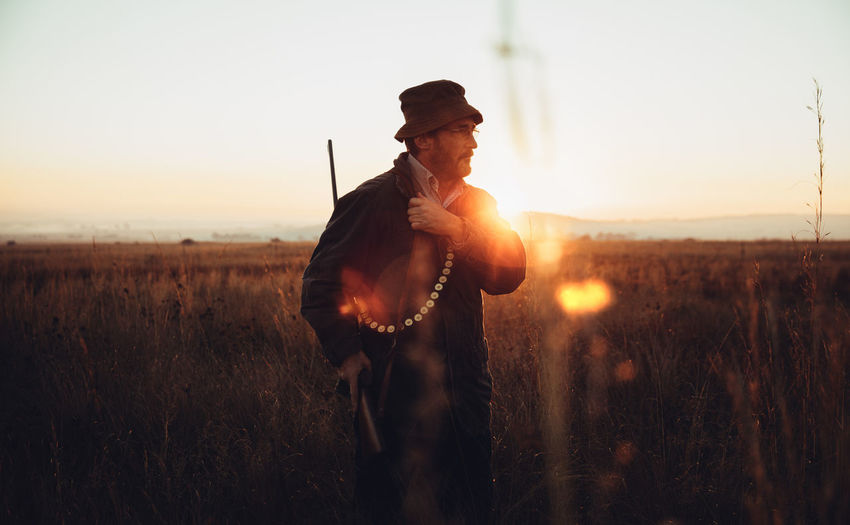 Agriculture Field Gun Hunter Hunting Leisure Activity Lens Flare Lifestyle Man Mature Meat Nature Outdoors People Pointing Prey Rural Scene Skill  Sniper Sunflare Sunlight Sunrise Sunset Tranquility Weapon