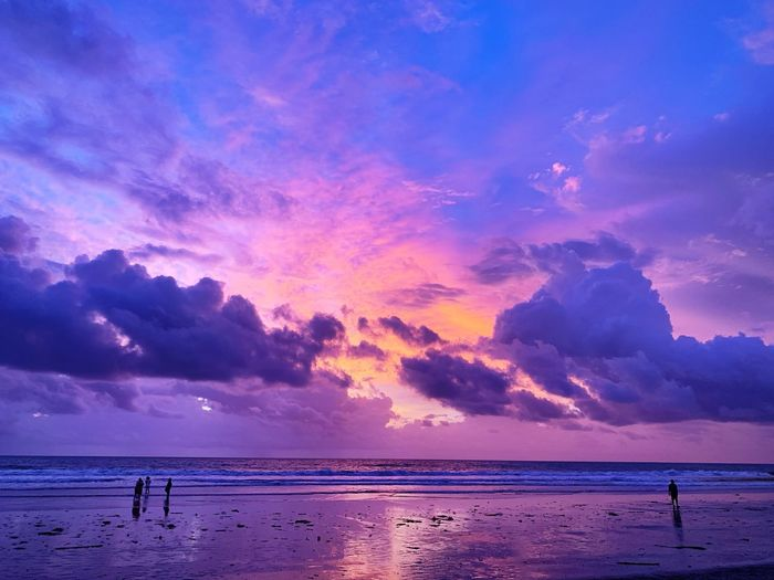 INDONESIA Bali EyeEmNewHere EyeEm Gallery Sky Water Sea Beauty In Nature Beach Scenics - Nature Land Cloud - Sky Sunset Horizon Tranquility Tranquil Scene Silhouette Real People Nature Pink Color Purple Horizon Over Water People Idyllic