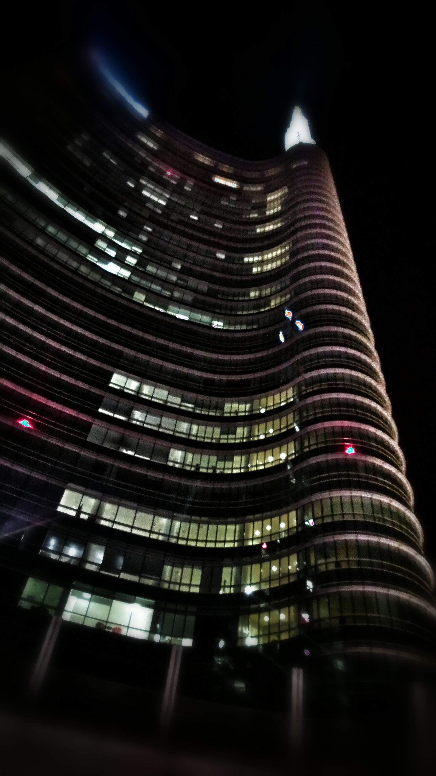 architecture, building exterior, night, illuminated, built structure, skyscraper, city, modern, low angle view, office building, tall - high, tower, building, capital cities, city life, no people, travel destinations, financial district, tall, outdoors