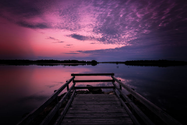 Purple seascape Water Sky Beauty In Nature Reflection Scenics - Nature Pier Tranquility Tranquil Scene Nature Cloud - Sky Sunset Jetty Wood - Material No People Outdoors Purple Scenics Landscape Taking Photos Summer Enjoying Life EyeEm Best Shots Nature_collection Backgrounds Sea