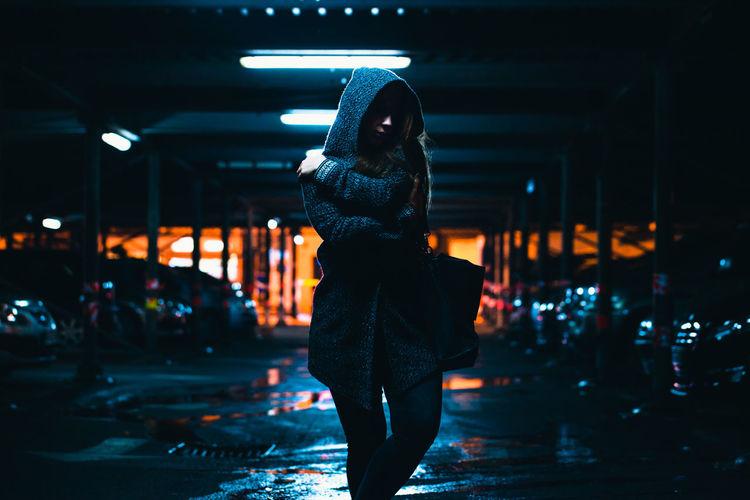 Woman walking in basement at night