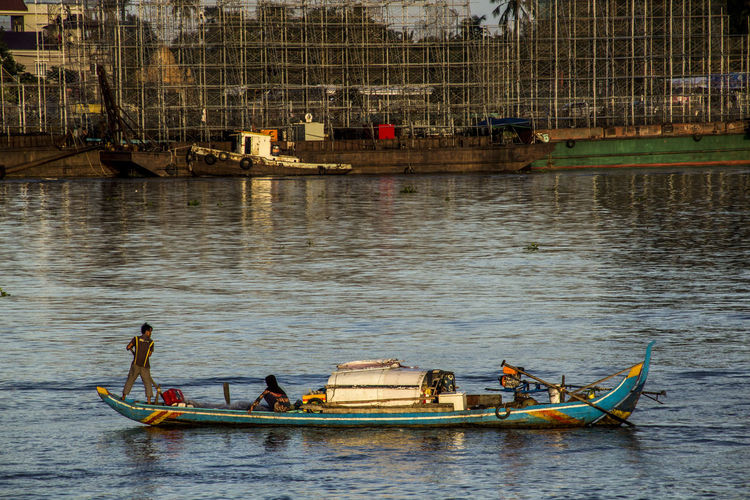 Cambodia Mekong River Day Fisherman Group Of People Men Mode Of Transportation Nature Nautical Vessel Oar Occupation Outdoors People Real People Reflection River Sailboat Sailing Transportation Travel Water Waterfront