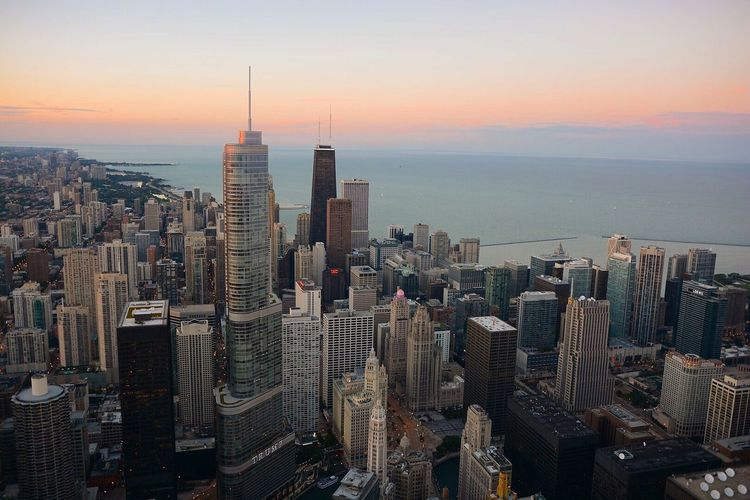 Skyscraper Cityscape Sunset Architecture Travel Destinations Building Exterior City Sea Chicago No People Water Aerial View High Angle View Urban Skyline Sky Outdoors Growth Scenics Horizon Over Water Day
