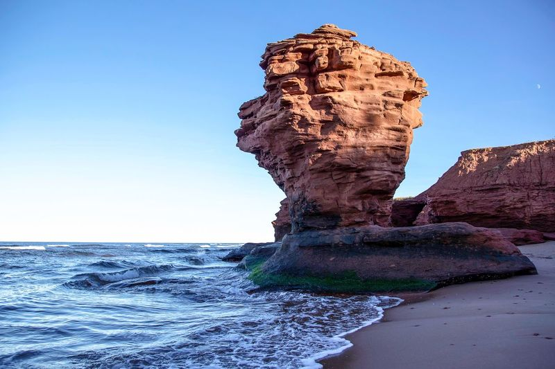 teacup rock EyeEm Best Shots EyeEmNewHere Seascape Prince Edward Island Rock Formation Rock - Object Beauty In Nature Nature Geology Sea Scenics Clear Sky Physical Geography Sky Day Outdoors Travel Destinations Horizon Over Water