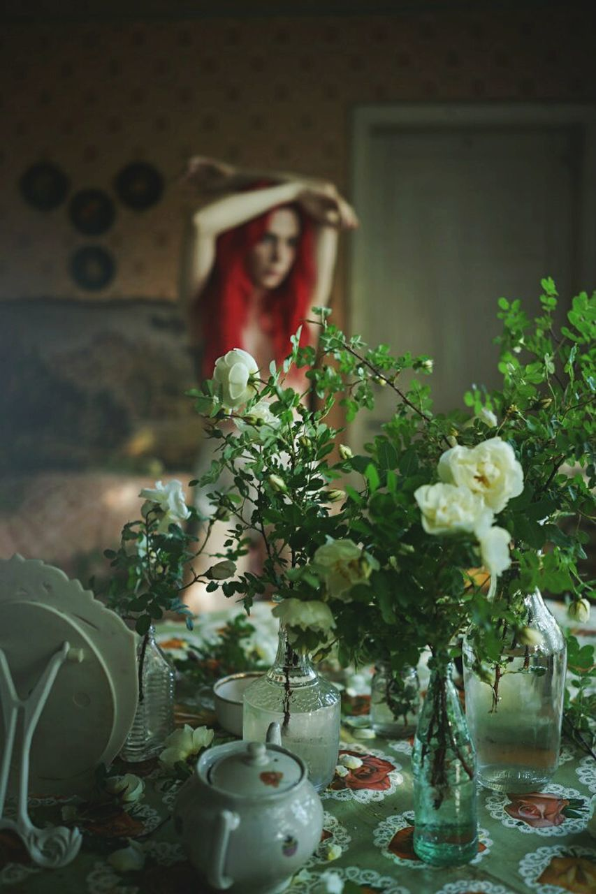 indoors, one person, flower, real people, day, plant, lifestyles, young women, fragility, close-up, young adult, people