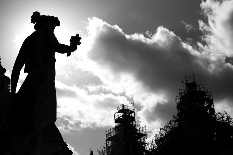 Low angle view of silhouette man against cloudy sky