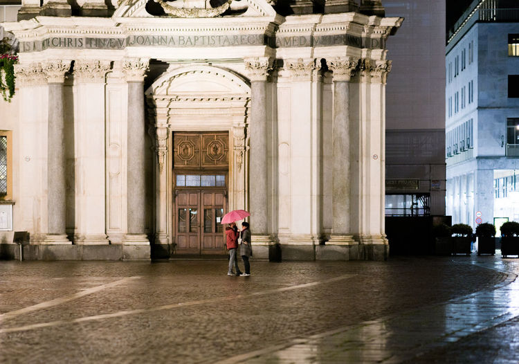 Rainy night in the city of turin Torino Rainy Season Outdoors Rain The Past Women Travel Destinations Building Architectural Column Adult Walking Day Arch City Lifestyles Rear View Men One Person Full Length Building Exterior Real People Built Structure Architecture Mirkomacaritorino