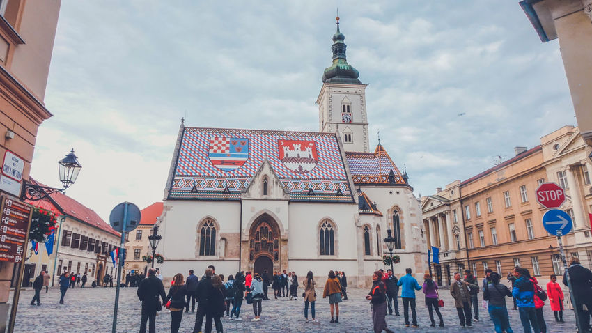 St. Mark's Cathedral in Zagreb, Croatia Church City Croatia Mosaic National Roof Sightseeing Zagreb Zagreb, Croatia Architecture Building Exterior Cloud - Sky Colorful Group Of People Large Group Of People Real People Religion Religious  Religious Architecture Roof Tile Sights Sky Town