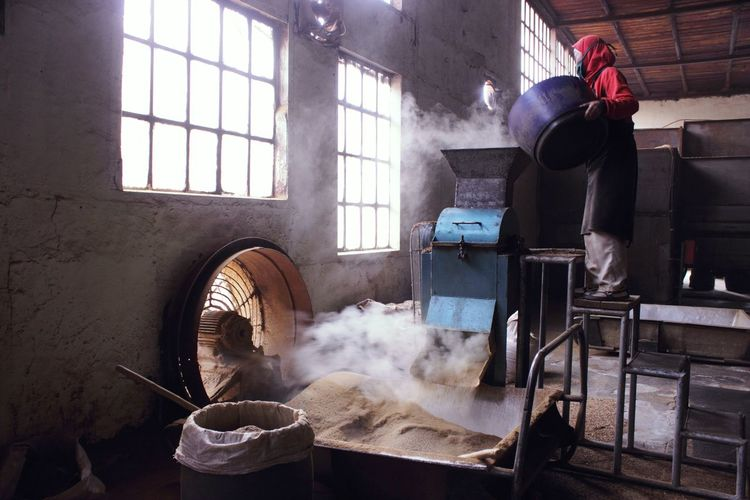 Built Structure Factory Workers Fan Indoors  Indoors  Smoke - Physical Structure Window Women Working