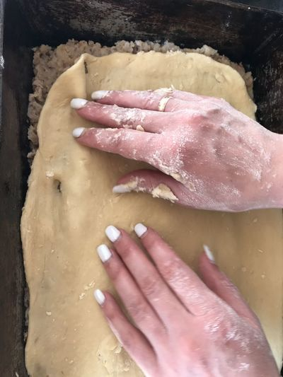 High angle view of hand preparing food