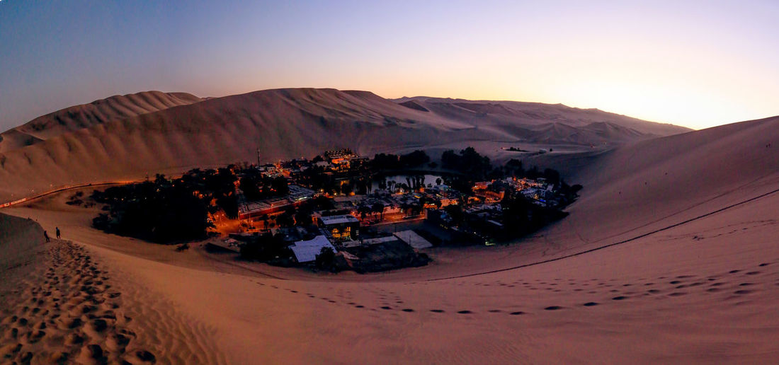 The calmness of the oasis in the middle of the desert right after sunset. Shot from Huacachina, Peru Huacachina Desert Oasis Oasis Peru Scenics - Nature Landscape Sunset Sand Dune Desert Ica Travel Destinations Travel Photography Tranquil Scene Travel Arid Climate No People Nature Beauty In Nature Outdoors South America Blue Hour Twilight Dusk Lowlight Panaroma First Eyeem Photo
