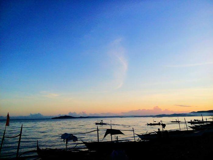 sunrise. ☀ Sunrise Beach Sea Water Sky Outdoors Philippines Beauty In Nature Vacations EyeEm Nature Lover EyeEm Best Shots Bicol Eyeem Philippines EyeEm Gallery Beauty In NatureTranquil Scene Silhouette No People Scenics Day Clear Sky Horizon Over Water Idyllic Tranquility Nature