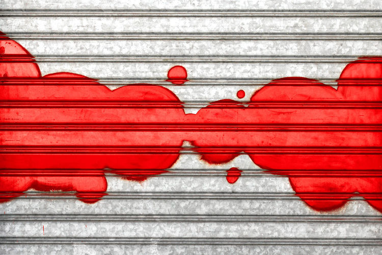Red bubbles painted with spray paint on a roller shutter. Abstract Art Backgrounds Balloons Brightly Bubbles Close-up Closed Colorful Deep Design Drawing Empty Grunge Nobody Painting Pattern Red Shape Spray Street Symbol Texture Vintage Wall