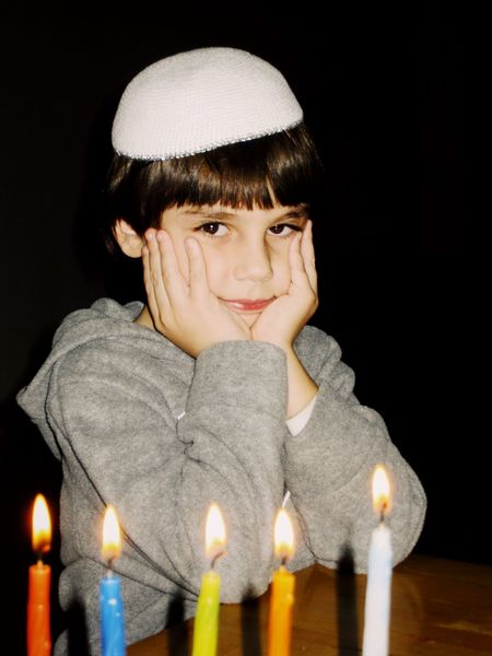 Hanukkah Chanukah מייחנוכה חנוכה Israel Contemplation Child One Person Studio Shot Looking At Camera Portrait Bangs Childhood Black Background Day Dreaming Burning Close-up People Day Light Effect Burning Candle Flame Holiday Candles