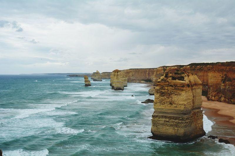 Twelve apostles sea rocks by sea against sky