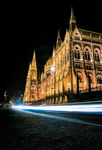 Light Trails Outside Matthias Church Against Sky At Night