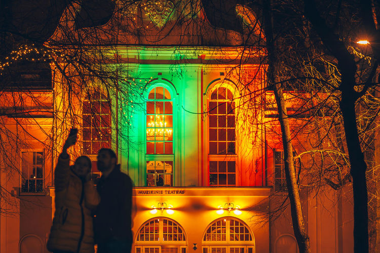 Colorful building. Lights festival City Lietuva Arch Architecture Building Exterior Built Structure Colorful Couple - Relationship Illuminated Indoors  Leisure Activity Lifestyles Lights Festival Long Exposure Love Men Night People Real People Togetherness Two People Women
