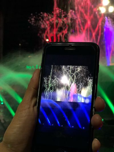 fonetain Fountain Show Human Hand Hand Illuminated Night Holding Real People Portable Information Device Technology