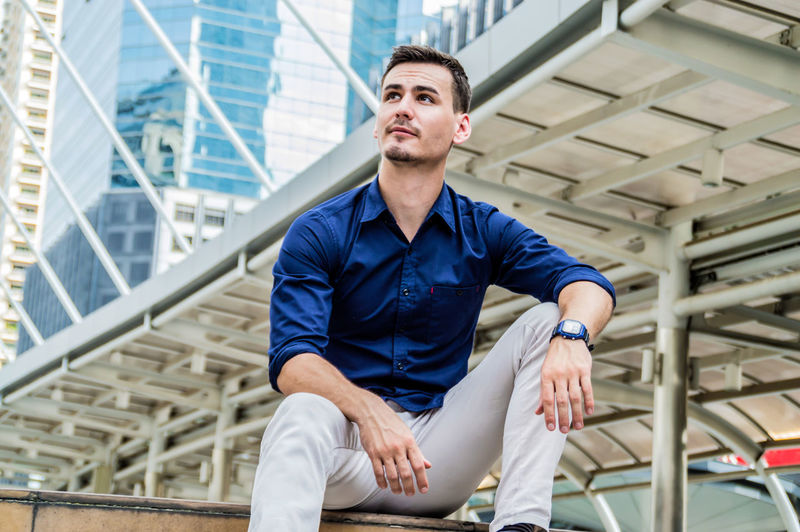 Adult Against American Await Background Banner Business Businessman Casual Caucasian Cellular Cheerful City Concrete Confident  Copyspace Education European  Face Fashion Grey Handsome Happy Horizontal Image Intelligent Leaning Man Masculine Outdoor People Photo Portrait Smart Smiling Student Study Style Stylish Success Successful Teach Trend Trendy Using Wait White Work Young Youth