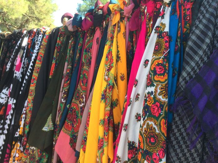 Multi colored scarves hanging for sale at market