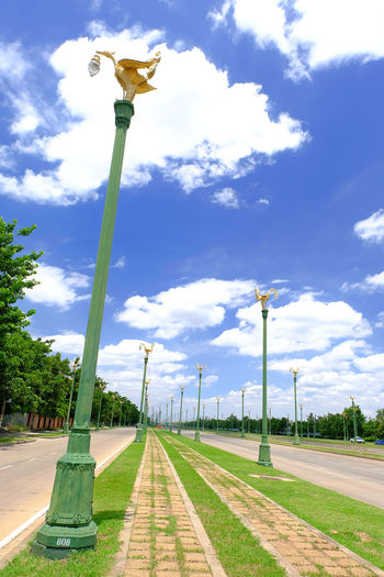 Statue of street light against blue sky