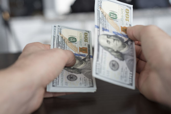 Close up personal perspective counting out one hundred dollar bills Accounting American Banking Cash Counting Currency Global Investing Investing Market Money Personal Perspective Spending