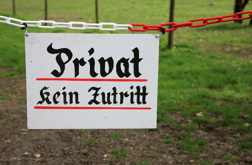 """Sign with the German words """"Privat kein Zutritt"""" translates into """"Private no admittance"""" in English language Close-up Communication Day Exclusion Focus On Foreground Forbidden Grass Hanging Information Information Sign Land Message Nature No Admittance No People Private Safety Script Sign Text Warning Sign"""