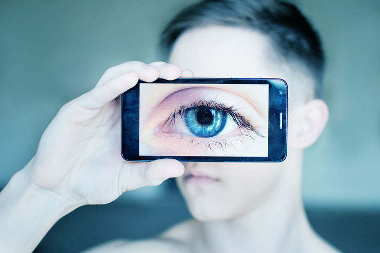 Close-up of human eye on smart phone
