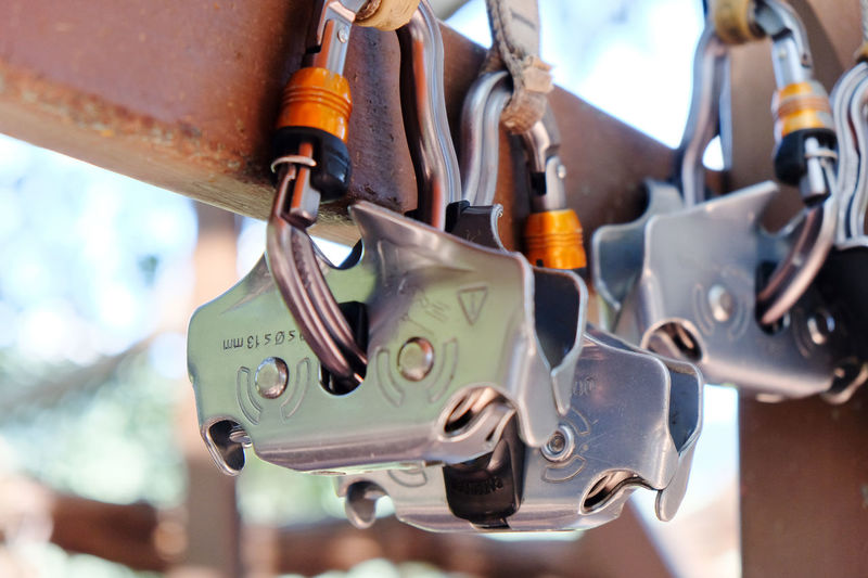 Close-Up Of Climbing Equipment Hanging On Wood